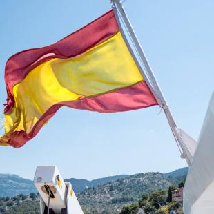 Spanish flag in front of landscape view